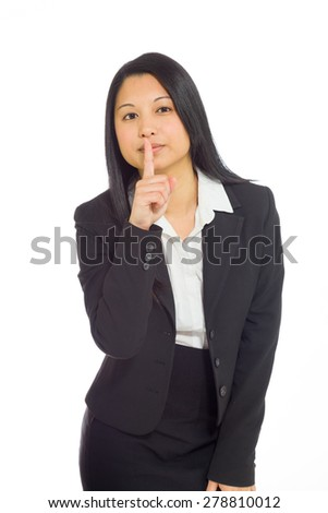 Model isolated on plain background in studio fingers on lips with secret