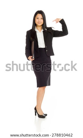 Model isolated on plain background in studio pointing - stock photo