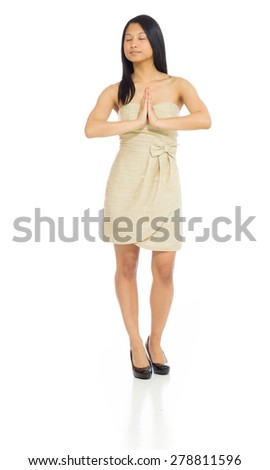 Model isolated on plain background in studio wishing praying