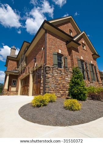 Model Luxury Home Exterior extreme view with garage - stock photo