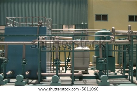 Model of a Factory -- partial view of a miniature production plant - stock photo