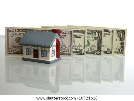 Model of a house on a background of dollars - stock photo