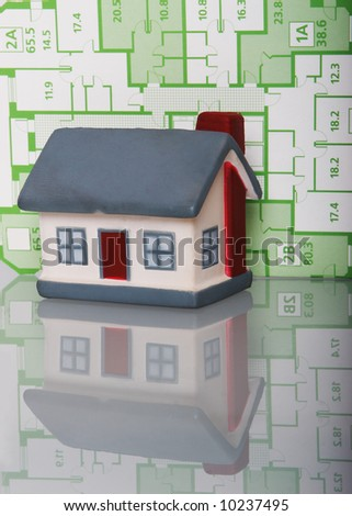 Model of a house on a background of the draft - stock photo