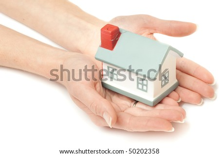 Model of a house on hands isolated on white - stock photo