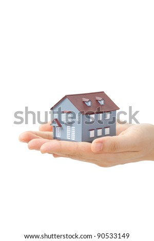 Model of a house on hands isolated on white background - stock photo