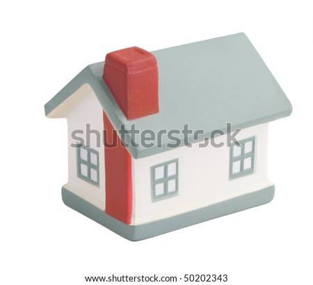 Model of a house on white - stock photo