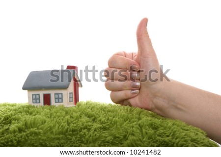 Model of a  house with hand as ok symbol - stock photo