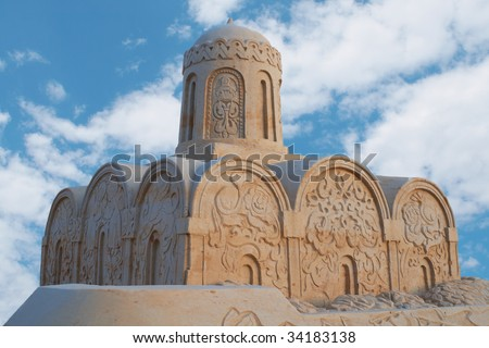 Model of an ancient temple from sand - stock photo