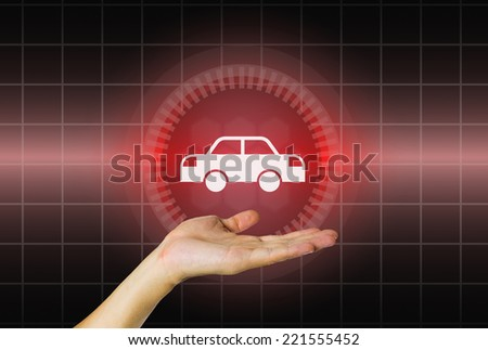 Model of car in hand on modern dark background. - stock photo