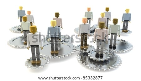 Model of 3D figures on connected silver cogs as a metaphor for a team - stock photo