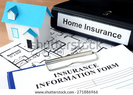 Model of house and folder with home insurance. Business  concept - stock photo