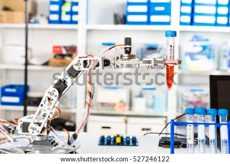 Model of industrial robot manipulator, robot arm with test tube