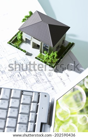 Model Of The House And A Laptop