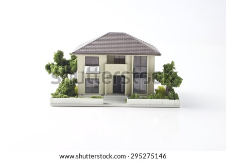 model of the house on white background - stock photo