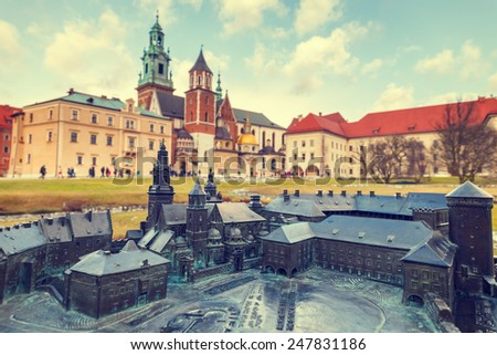 model of the Royal Castle in Krakow with real buildings in the background, Braille system - stock photo