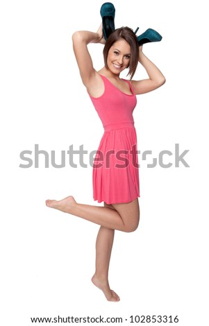 Model poses like a bunny as she uses her shoes to make rabbit ears - stock photo