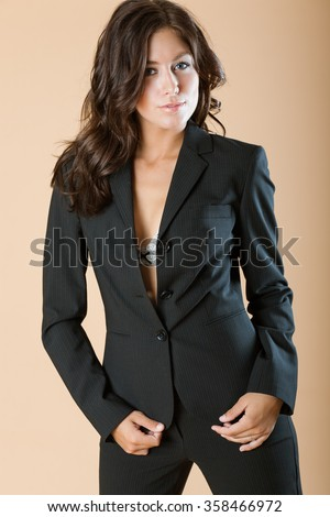 Model poses wearing a suit - stock photo