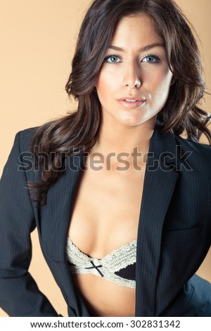 Model poses wearing unbuttoned suit  - stock photo