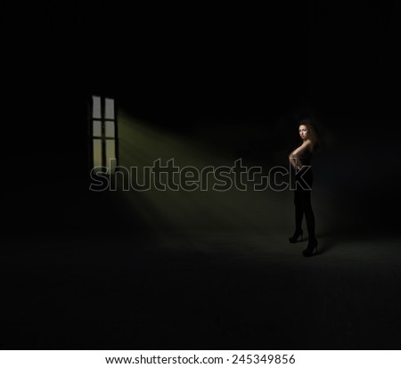 model posing in front of a window - stock photo