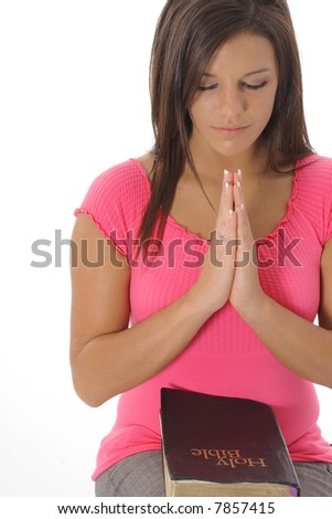 model praying over a bible - stock photo