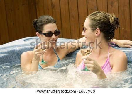 Model Release 353  Two women in their mid 20s enjoying a relaxing moment in a hottub - stock photo