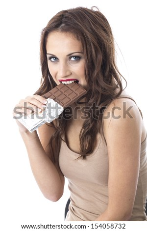 Model Released. Attractive Happy Young Woman Eating Chocolate