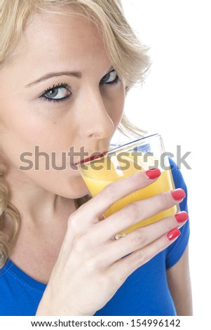 Model Released. Attractive Young Woman Drinking Orange Juice