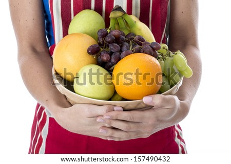 Model Released. Attractive Young Woman Holding Fresh Fruit