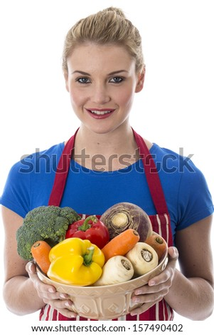 Model Released. Attractive Young Woman Holding Fresh Raw Vegetables