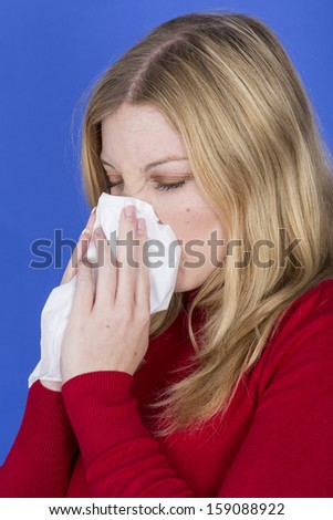 Model Released. Attractive Young Woman Sneezing