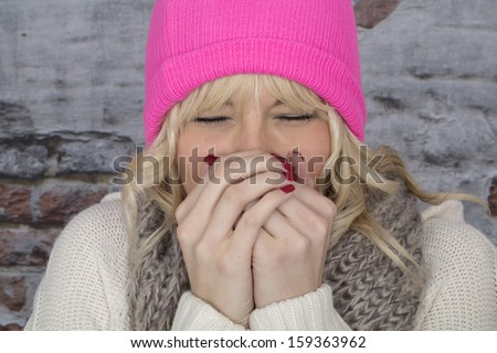 Model Released. Attractive Young Woman Sneezing - stock photo