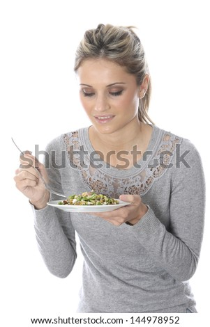 Model Released. Young Woman Eating Wholefood Salad