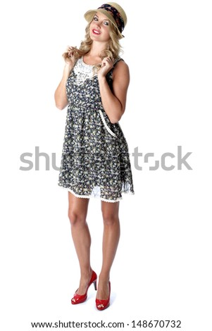 Model Released. Young Woman Wearing Straw Hat and Mini Dress