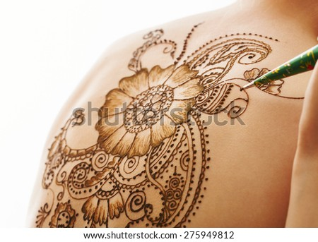 Model's back with beautiful pattern of henna - stock photo