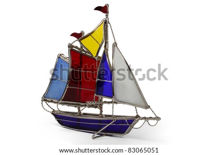 Model sailboat made of glass, isolated on a white background - stock photo