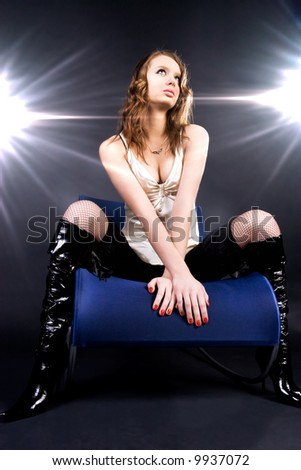 Model superstar. Two bright flashes behind. - stock photo