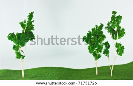 model tree and grass