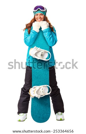 model wearing snoboard suit holding a snowboard in studio - stock photo