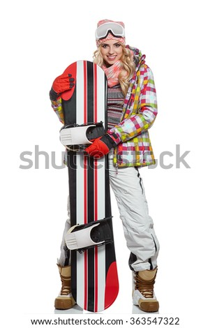 model wearing snowboard suit holding a snowboard in studio