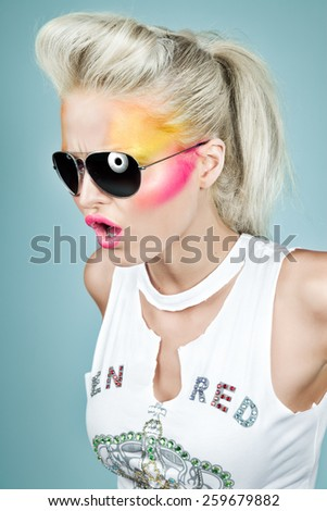 Model wearing sunglasses. Mass-market shirt design slightly altered. - stock photo
