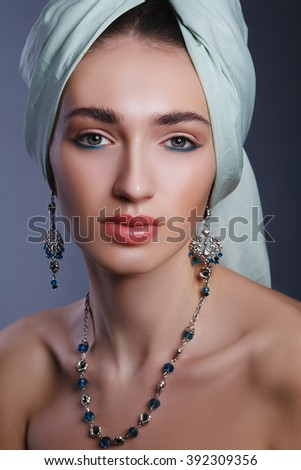 Model with a bandage on head in the Indian style model. Fashion and jewelry