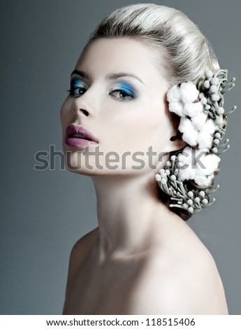 model with a professional makeup and flowers in her hair