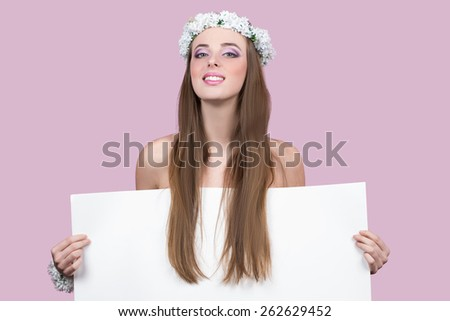 model with bright flowers holding a blank poster