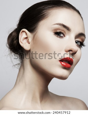 Model with chic lips make-up with red lipd long lashes - stock photo