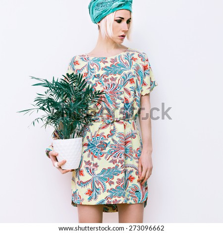 Model with flower in trendy summer Dress - stock photo