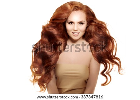 Model with long red hair. Waves Curls Hairstyle. Hair Salon. Updo. Fashion model with shiny hair. Woman with healthy hair girl with luxurious haircut. Hair loss Girl with hair volume.  - stock photo