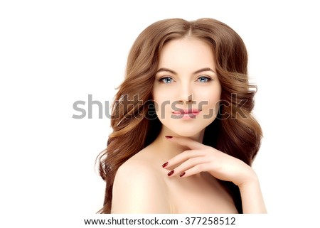 Model with long wavy hair. Waves Curls Hairstyle. Hair Salon. Updo. Fashion model with shiny hair. Woman with healthy hair girl with luxurious haircut. Hair loss Girl with hair volume. Brunette - stock photo