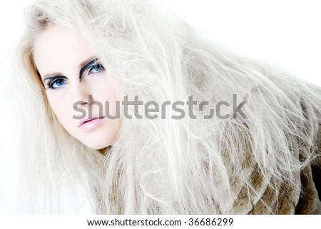 Model with white hair in a high fashion pose looking curious at the viewer. Usable for health and beauty, cosmetics, love, hate and emotional issues.