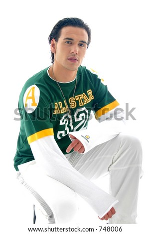 Model with white pants and green shirt