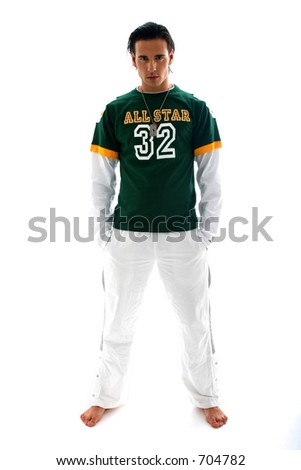 Model with white pants and green shirt standing up - stock photo